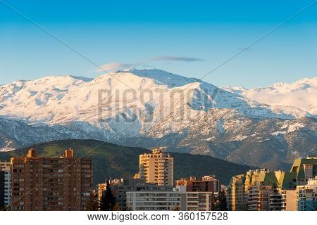 Skyline Of Residential Apartment Buildings At Las Condes District With Snowed Los Andes Mountain Ran