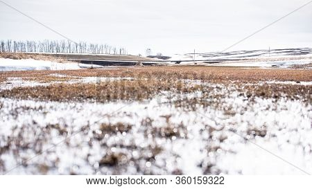 Early Spring. Landscape Of Early Spring, Snow Begins To Melt, Fields Open, Days Become Clear.