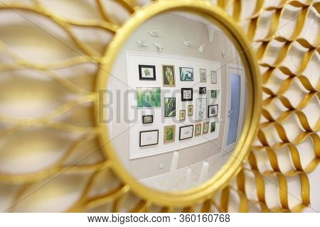 On The Wall There Is A Round Mirror Stylized Under The Sun. Bright Yellow Color. The Mirror Reflects