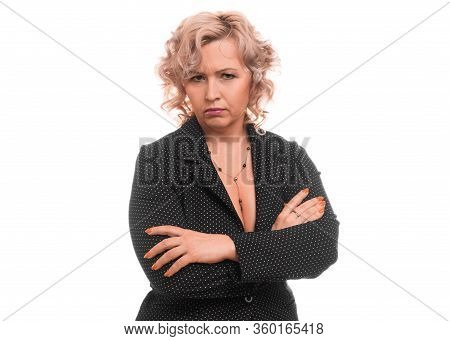 Close Up Portrait Of An Angry Middleaged Businesswoman Over White Background.