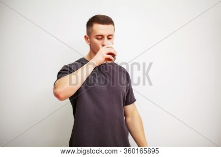 Man Takes A Pill Of Amino Acids After Training.