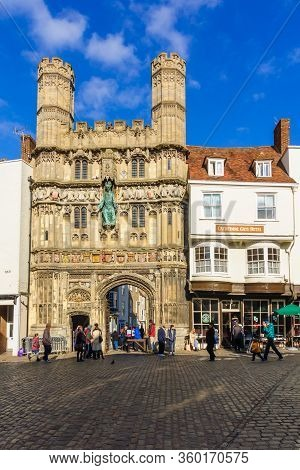 Canterbury, Uk - February 20, 2013: Street Scene With The Christchurch Gate Of The Cathedral, Locals