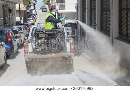 Workers Sprays Disinfectant As Part Of Preventive Measures Against The Spread Of The Covid-19