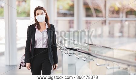 Beautiful Cute Asian Businesswoman Wearing Protective Surgical Hygiene Mask On Face In The Situation