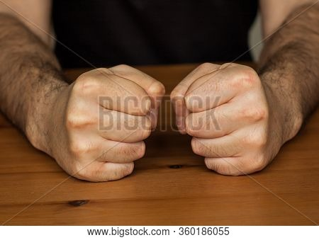 Anger Management, Two Hands Fists On Wooden Table Clench Hairy Man Fists Symbol Angry
