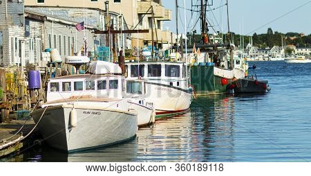 Portland, Maine, Usa - 25 July 2020: Fishing And Lobster Boats Docked In An Inlet With Lobster Traps