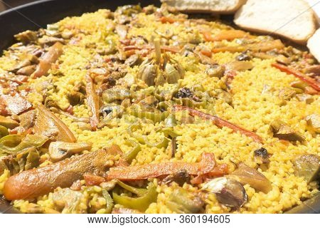 Vegetable Paella Made On Fire With Organic Ingredients. Shot Made In Monforte Del Cid, Alicante Spai