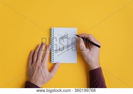 Male Hands Crossing Off The Word Crisis And Writing Word Opportunity In A Conceptual Image Of Person