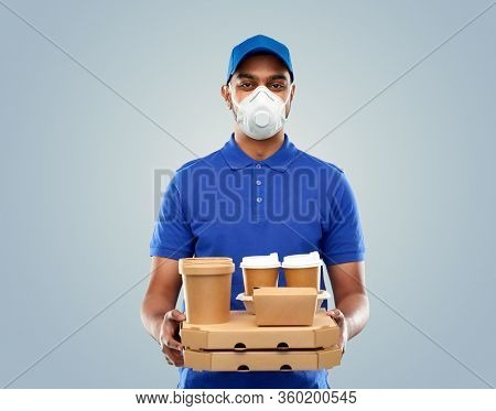 health, safety and pandemic concept - indian delivery man wearing face protective mask or respirator for protection from virus disease with food and drinks in blue uniform over grey background