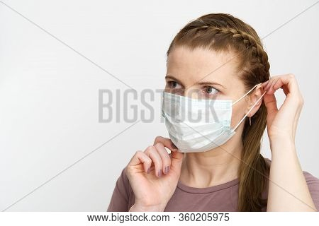 Woman Wearing Medical Mask. Masked Woman - Protection Against Influenza Virus. Ear With Protective F