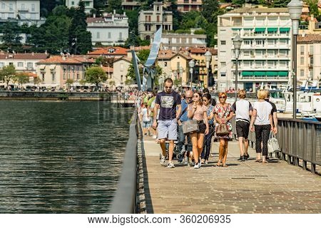 Como, Italy - August 4, 2019: Local People And Tourists On The Promenade Along The Lake In The Cente