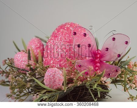 Pink And Green Nest Wreath With A Large Pink Easter Egg And Smaller Pink Easter Eggs Sitting On It W