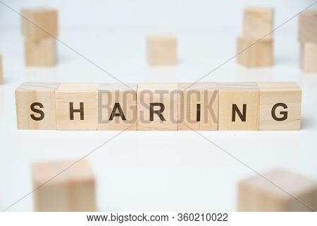 Modern Business Buzzword - Sharing. Word On Wooden Blocks On A White Background. Close Up.