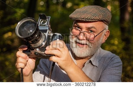 He Likes Birdwatching. Pension Hobby. Experienced Photographer. Vintage Camera. Old Man Shoot Nature