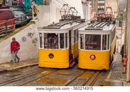 Lisbon, Portugal - 3 March 2020: Elevador Da Glória Yellow Funiculars In Bairro Alto District