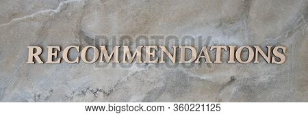 Recommendations , Writen Wooden Letters On Stone Background
