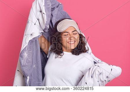 Studio Shot Of Happy Woman Waking Up After Good Sleeping, Stays At Home During Quarantine, Having Sa