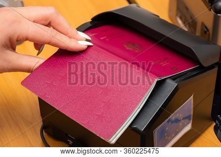 The Process Of Scanning A German Biometric Passport To Register The Fact Of Crossing The State Borde