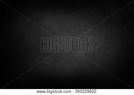 Close-up of dark black grunge textured background