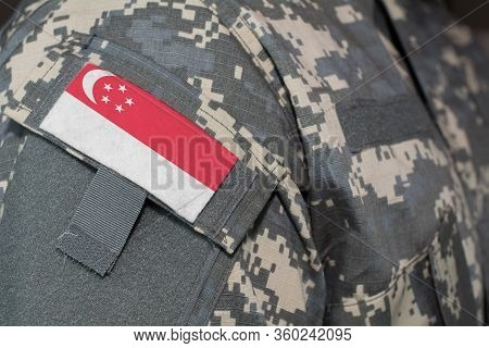 Singapore Army Uniform Patch Flag On Soldiers Arm. Military Concept.