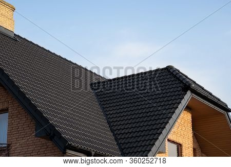 Brown Metal Tile Roof. Roof Metal Sheets. Modern Types Of Roofing Materials. Roof Of The House, Meta