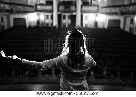 Entertainer Performing On A Stage In A Empty Theater,concert Hall Without Fans.no Audience.covid-19