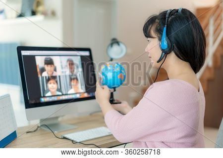 Asian Woman Teacher Teaching Geography Via Video Conference E-learning And Cheerful Elementary Schoo