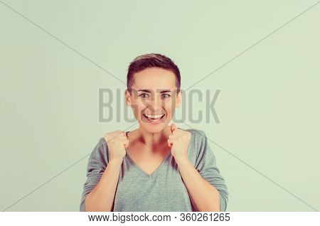 Lucky Girl. Closeup Portrait Happy Young Woman Happy Exults Pumping Fists Ecstatic Isolated Green Wa