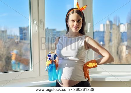 House Cleaning, Young Beautiful Pregnant Woman In Gloves With Rag And Detergent Posing, Looking At C