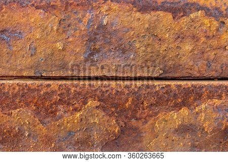 Heavily Rusted And Corroded Metal Sheet In An Industrial Area, Suitable As A Background, Pattern And