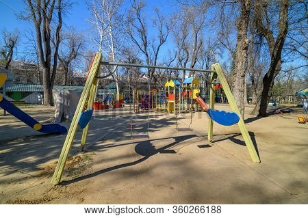 Chisinau, Moldova - March 16, 2020: Empty children playground in cathedral square park in the center of city during quarantine by reason of coronavirus AKA covid-19 virus threat. State of emergency
