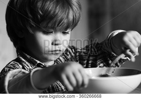 Baby Eating. Food And Drink For Child. Portrait Of Sweet Little Laughing Baby Boy With Blonde Hair E