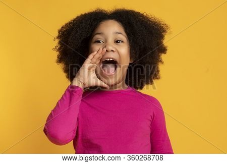 Funny Little African American Girl Emotionally Screaming, Making Announcement, Loudly Shouting With