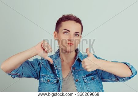 Thumb Up Or Thumb Down. Skeptical Thinking Woman Judging Deciding How To Rate A Situation. Is It Goo