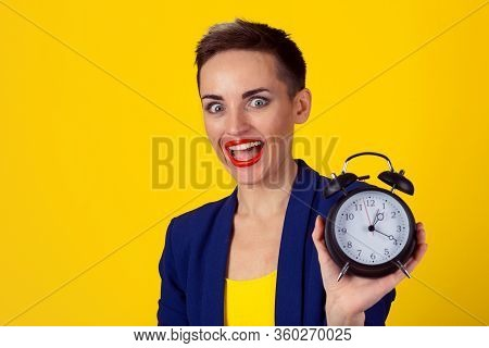 Anticipation. Headshot Young Funny Looking Excited Business Woman Holding Alarm Clock Waiting Isolat