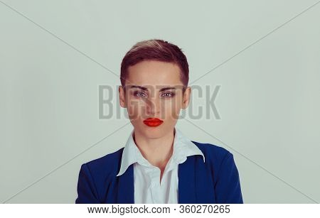 Attractive Serious Woman Isolated Green Grey Background With Copy Space. Short Hair, Blue Navy Suit,