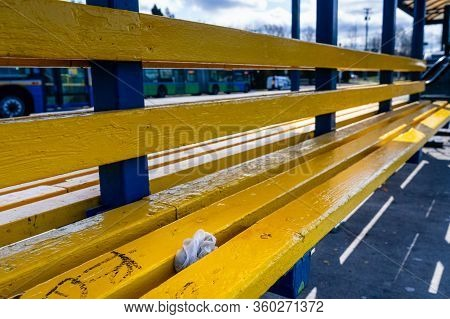 N. Vancouver - Apr 7, 2020: Used Medical Gloves Discarded Between Seat Slats At Public Bus Station D