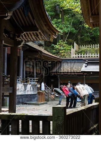 Chino, Nagano Prefecture, Japan - October 22, 2017: Group Of Visitors Performing A Shinto Ritual At