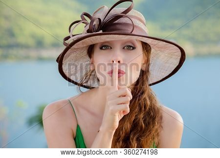 Woman Wide Eyed Asking For Silence Or Secrecy With Finger On Lips Hush Hand Gesture. Pretty Girl Pla