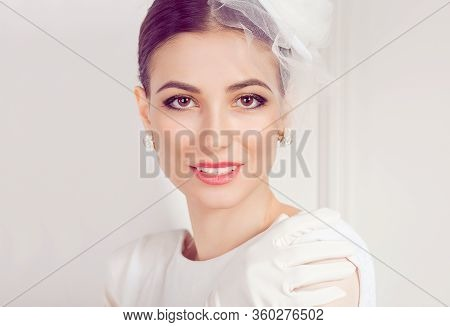Retro Woman Portrait. Closeup Portrait Beautiful Young Woman Looking Side Wards Isolated White Wall