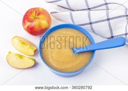 Baby Food. Fresh Homemade Applesauce. Blue Bowl With Fruit Puree On Fabric And Cut Apples On Table.