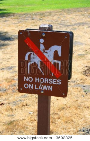 No horses on lawn sign in a park. poster