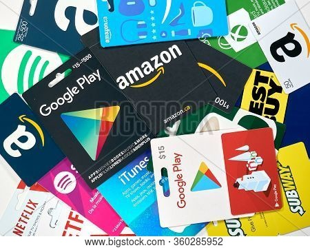 Montreal, Canada - April 6, 2020: Different Gift Cards Of Many Brands Such As Amazon, Netflix, Xbox,