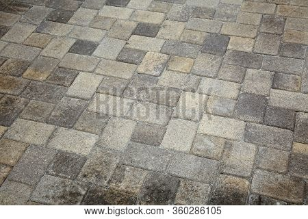 Paving Stones. Cement Bricks. Construction Materials. concrete paving slabs. backgrounds. cement paving stones. brick wall. room for text. industrial stone work.