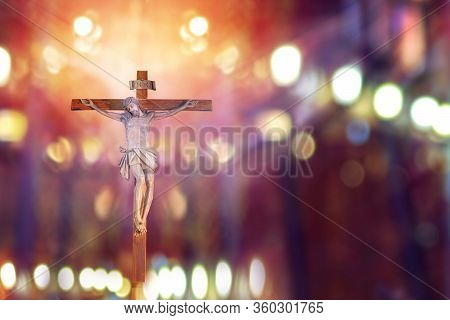 Crucifix, Jesus On The Cross In Church With Ray Of Light From Stained Glass, Easter Festival Of The