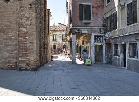 Venice, Italy - July 1, 2017: A View Of The Narrow Streets Of Venice, The Colorful Venetian Houses,