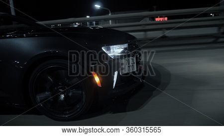 Tomsk, Russia - March 30, 2020: Chevrolet Camaro Zl1 The Exorcist Rides On The Road At Night Side Vi