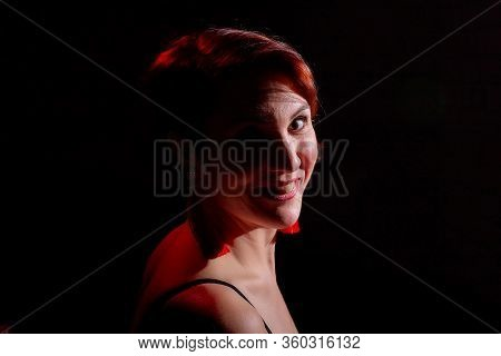 Portrait Of A Beautiful , Charming Young Woman In A Red And Black T -shirt Or A Combination With Lac