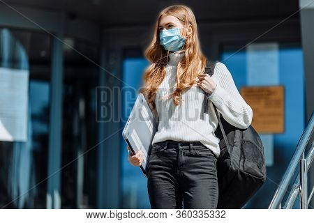 Beautiful Young Girl In A Mask From Coronovirus, Student On The Background Of Educational Envy, Wome