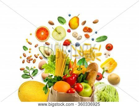 Shopping Bag Full Of Fresh Healthy Food Vegetables And Fruits. Groceries On White Background.